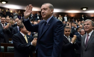 Turkey's PM Erdogan greets members of parliament from his ruling AK Party (AKP) during a meeting at the Turkish parliament in Ankara